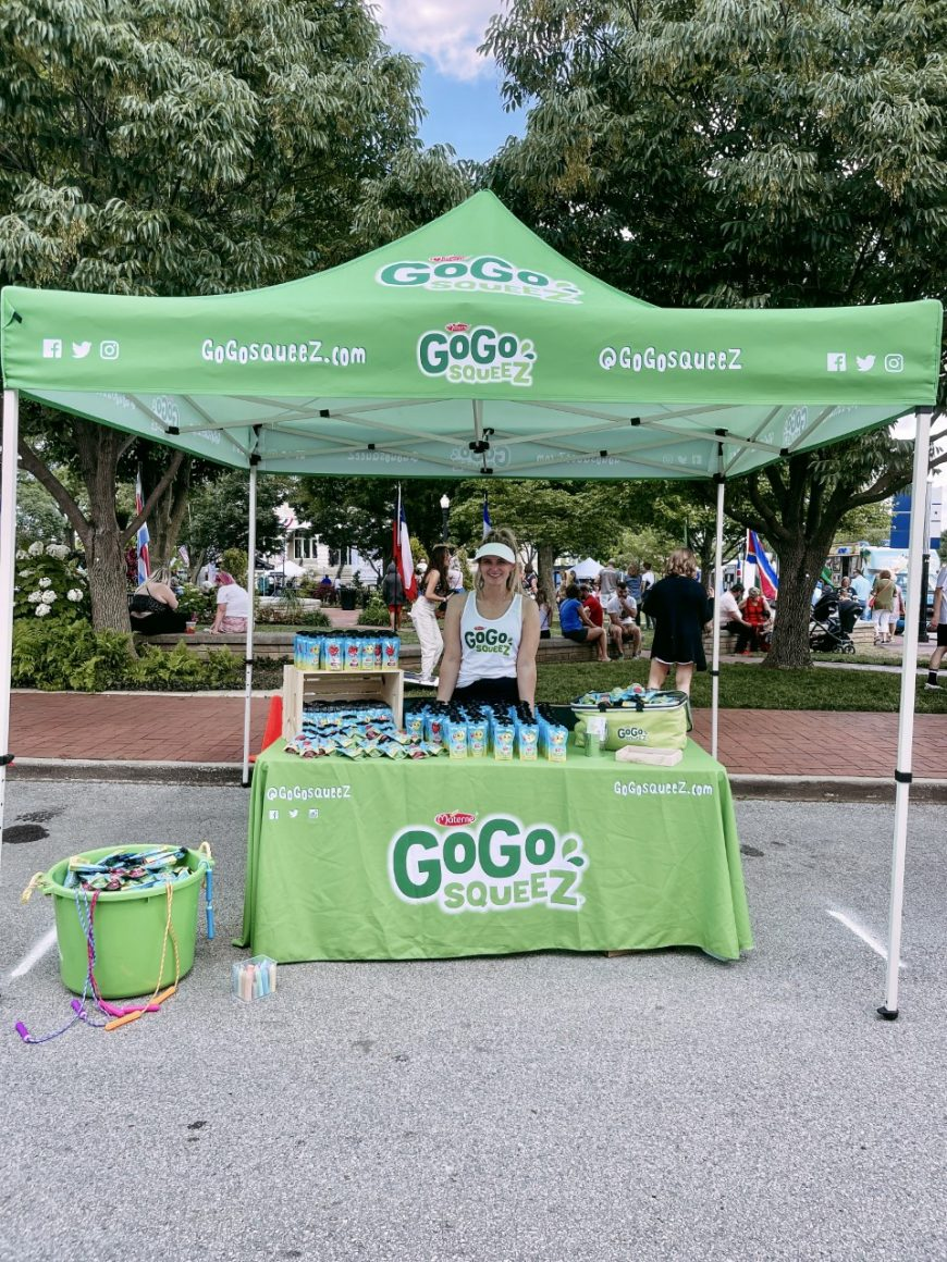 Tent and table with GoGoSqueez products